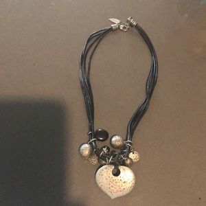 Triple leather strung heart necklace